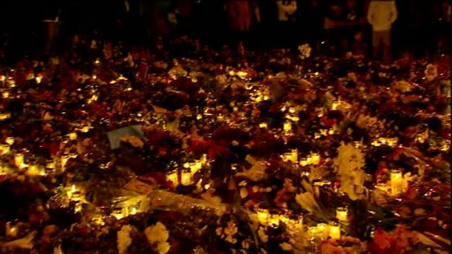 stockvideo's en b-roll-footage met massacre gunman anders breivik appears in court norway oslo people looking at mass of floral tributes and lit candles in street pan - anders behring breivik