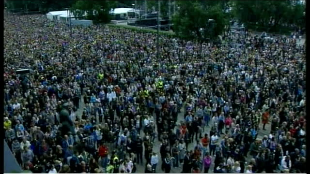 stockvideo's en b-roll-footage met massacre gunman anders breivik appears in court oslo ext high angle view of crowd of people high angle view of two young women hugging people holding... - anders behring breivik