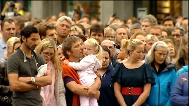 Massacre gunman Anders Breivik appears in court Oslo GV People in street observing silence GV People standing behind field of flowers outside...