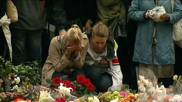 stockvideo's en b-roll-footage met massacre gunman anders breivik appears in court oslo mourners crying by floral tributes - anders behring breivik