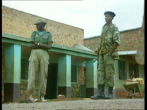 Uganda reaction ITN LIB LAMS Two RPF soldiers in front of building CS Explosives attached to belt of RPF soldier MS Two RPF soldiers LMS Deserted...