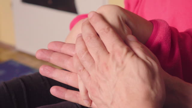 massage of disabled hand - cerebral palsy stock videos & royalty-free footage