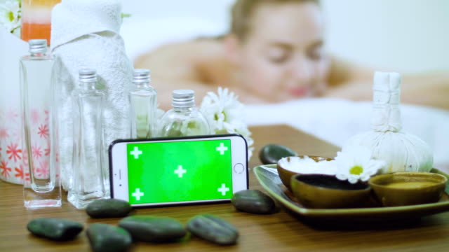 massage relaxation with chroma key on smart phone - massaging stock videos & royalty-free footage