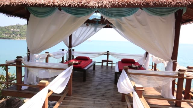 Massage table overlooking the sea. Spa massage room on the beach in Thailand