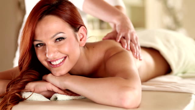 massage therapist massaging a young woman - adults only stock videos & royalty-free footage