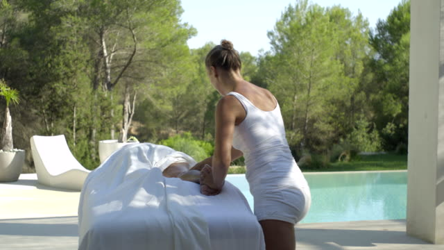 massage therapist works calf muscle of mature woman - masseur stock videos & royalty-free footage