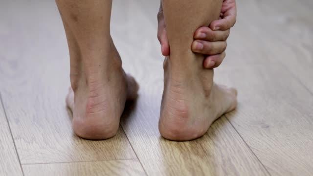 massaging sore foot - rubbing stock videos & royalty-free footage