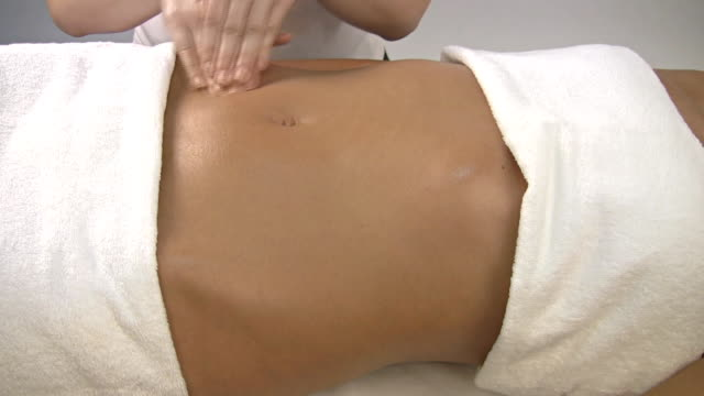 Massaging stomach