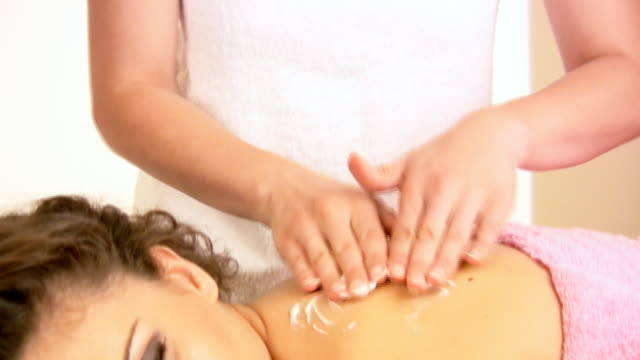 hd: massaging - lying on front stock videos & royalty-free footage
