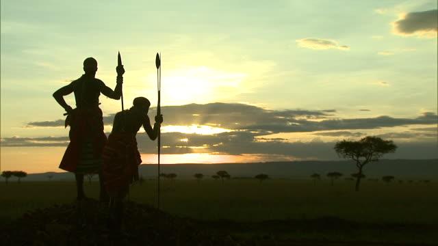 massai tribesmen overlook an african savanna. - feierliche veranstaltung stock-videos und b-roll-filmmaterial