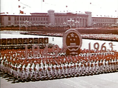 masses of people celebrating the anniversary of china's revolution / parades flags drums dancers and shirtless men marching / crowds marching and... - revolution stock videos & royalty-free footage