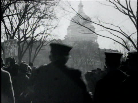 ms masses of people milling near the capital building policemen standing by / washington district of columbia united states - 1932 stock-videos und b-roll-filmmaterial