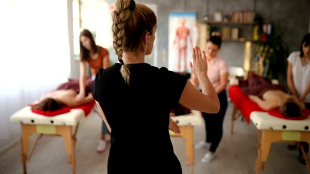 masseuse direct her students about mistake they made while massaging - massage stock videos & royalty-free footage