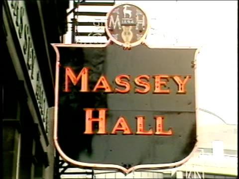 massey hall sign and crowds outside in toronto - fahrkartenschalter stock-videos und b-roll-filmmaterial