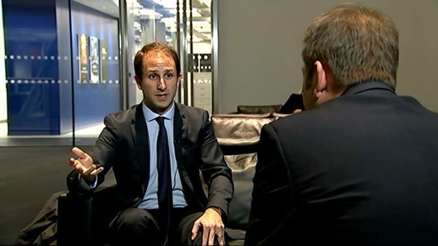 massimo cellino disqualified from being in charge of leeds united various shots daniel geey speaking to reporter daniel geey interview sot - charging sports stock videos & royalty-free footage