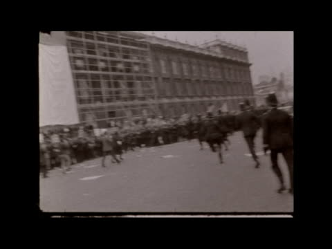 massive anti-vietnam demonstration in london; england: london: whitehall: ext line of police contains crowd in whitehall pan over crowd l-r to... - war stock videos & royalty-free footage