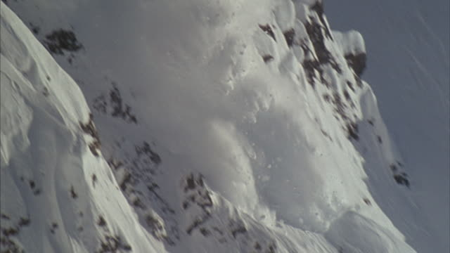 A massive avalanche speeds down a mountainside in Tibet.