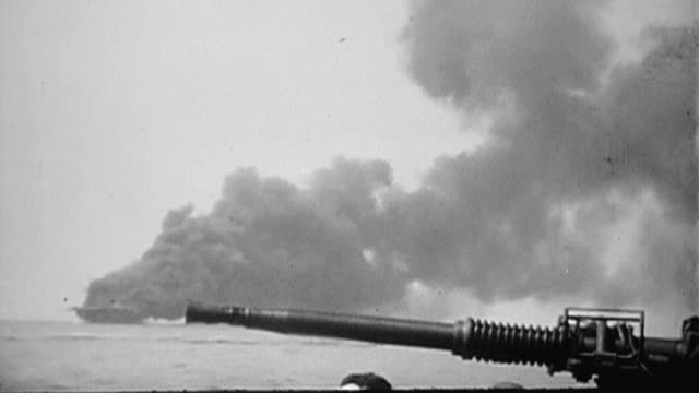 massive black cloud of smoke billowing from uss bunker hill hit by two kamikaze attacks and burning during world war ii with antiaircraft gun and gun... - flugabwehr stock-videos und b-roll-filmmaterial