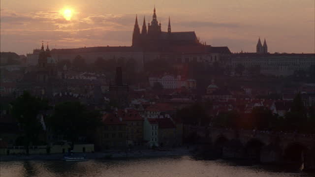 a massive cathedral dominates the skyline in prague, czechoslovakia. - czech republic stock videos & royalty-free footage
