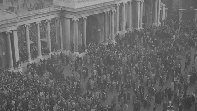 a  massive crowd begins dispersing following the funeral procession of king george v in london's hyde park. - british royalty stock videos & royalty-free footage