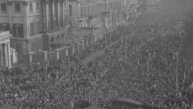 a massive crowd follows the funeral procession of king george v in london. - british royalty stock videos & royalty-free footage