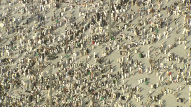 A massive crowd gathers around the Kaaba and across Mecca.