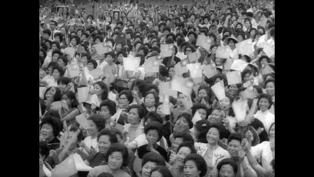 stockvideo's en b-roll-footage met massive crowd in taipei celebrating inauguration of president chiang kaishek / cu chiang standing above crowd watching the event / crowd waving flags... - chiang kai shek