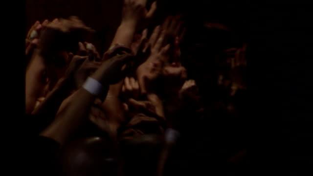 vídeos de stock e filmes b-roll de a massive crowd of men raise their hands and surge across a pavilion during the hadaka matsuri, the naked men festival, in okayama, japan. available in hd - casa de jardim