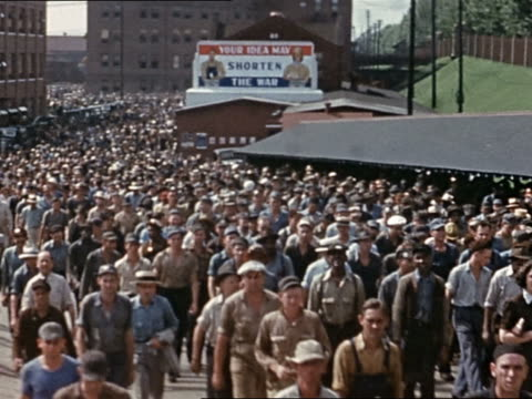 1945 massive crowd of shipyard workers walking outside factory buildings / United States
