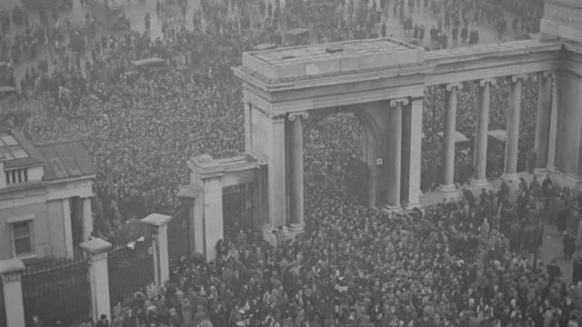 a massive crowd surges through hyde park following the funeral procession of king george v. - british royalty stock videos & royalty-free footage