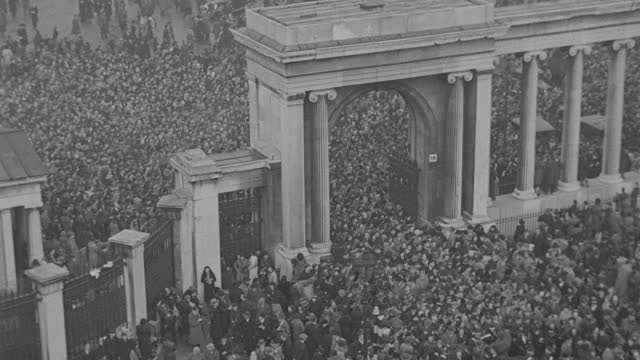 a massive crowd surges through hyde park following the funeral procession of king george v in london. - british royalty stock videos & royalty-free footage