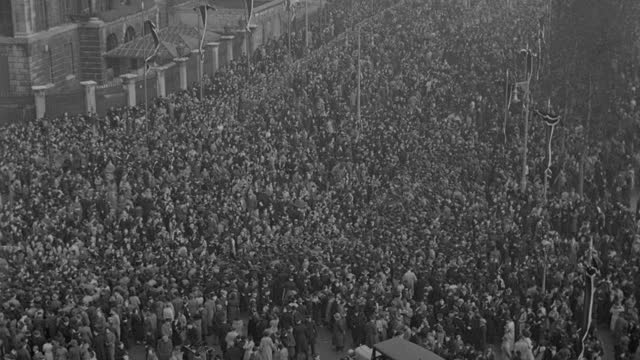 a massive crowd watches the funeral procession of king george v in london. - british royalty stock videos & royalty-free footage