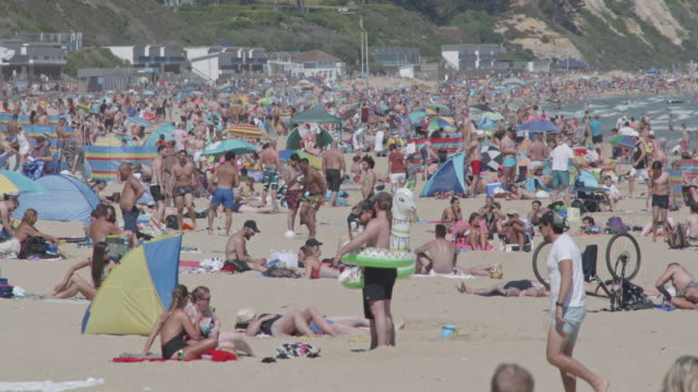 massive crowds gather on bournemouth beach making social distancing is almost impossible on may 31 2020 in bournemouth england the deputy chief... - semi dress stock videos & royalty-free footage