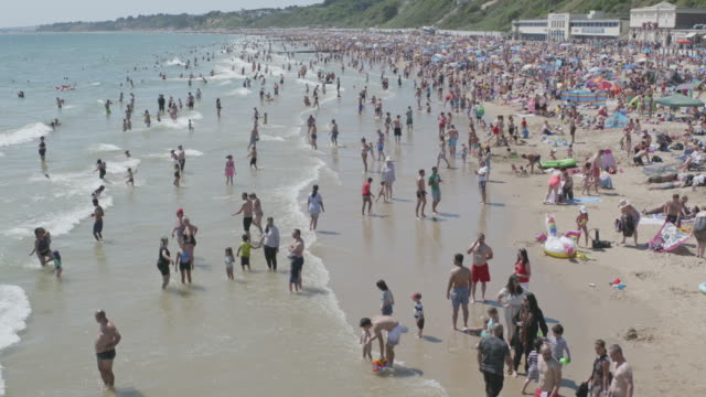massive crowds gather on bournemouth beach making social distancing very difficult on may 31 2020 in bournemouth england the deputy chief medical... - semi dress stock videos & royalty-free footage