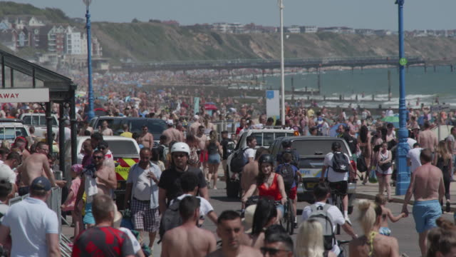 dorset england may 31 massive crowds gather undercliff drive next to bournemouth beach making social distancing is almost impossible on may 31 2020... - semi dress stock videos & royalty-free footage