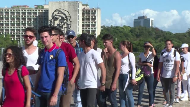 massive crowds of cubans streamed onto havana's iconic revolution square to pay tribute to fidel castro on monday kicking off an emotional week-long... - titan moon stock videos & royalty-free footage