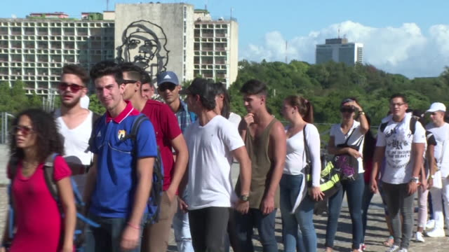 massive crowds of cubans streamed onto havana's iconic revolution square to pay tribute to fidel castro on monday kicking off an emotional week long... - titan moon stock videos & royalty-free footage
