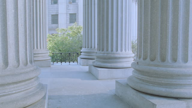 massive, doric columns support the new york city courthouse. - doric stock videos & royalty-free footage