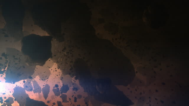 vidéos et rushes de a massive explosion sends debris and fiery rocks streaming to earth where it kills dinosaurs in a computer generated animation. - météore