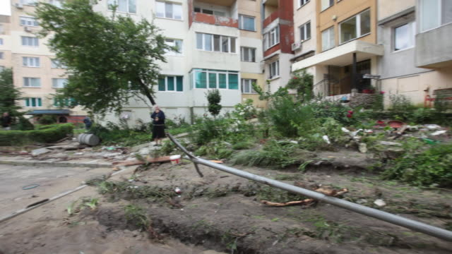 vídeos de stock, filmes e b-roll de massive flash flooding and mudslides in the district of asparuhovo varna bulgaria at least 11 people have died some of the victims are children the... - só uma mulher idosa