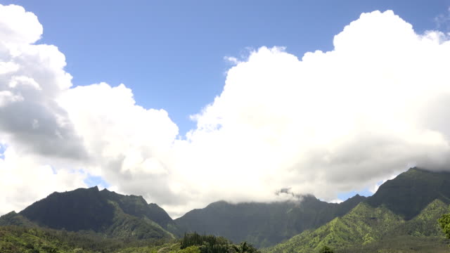 massive groups of clouds rolling overhead on kauai island - butte rocky outcrop stock videos & royalty-free footage
