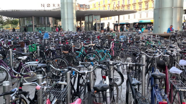massive number of bicycles at norrebro station in copenhagen - sustainable tourism stock videos & royalty-free footage