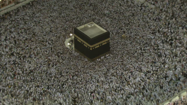 A massive ocean of people gather around Kaaba, or the Sacred House at Mecca.
