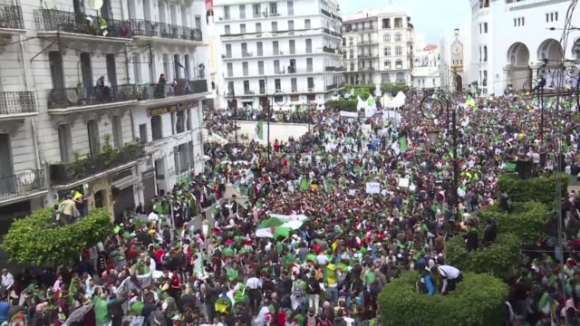 a massive procession marches through central algiers for an 8th consecutive friday of protest the first since the interim president took office and... - nachfolger stock-videos und b-roll-filmmaterial