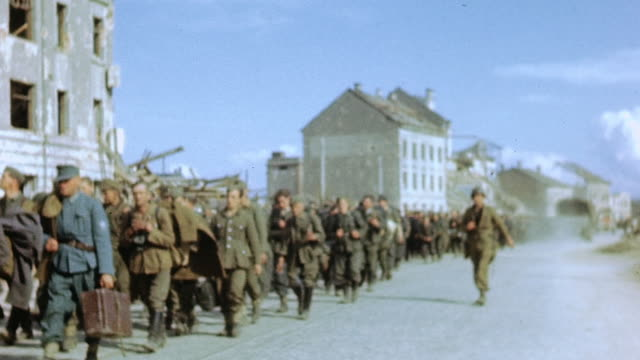 massive queue of german army prisoners of war being marched along bomb-damaged street / germany - german military stock videos & royalty-free footage