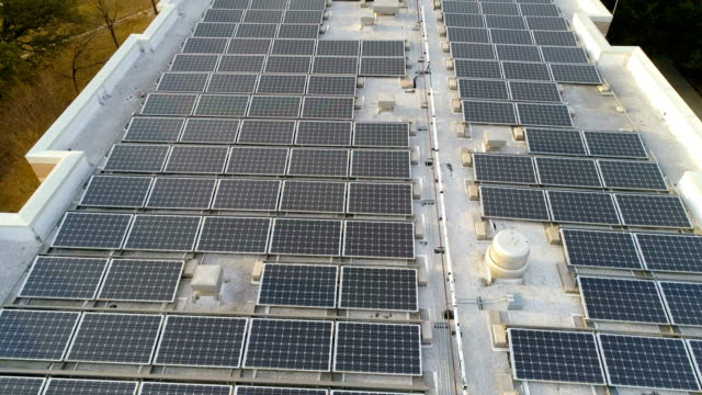 massive rooftop solar panel array powering our future moving forward over solar panels - roof top stock videos and b-roll footage