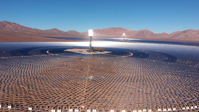 a massive solar power collective station with solar panels collecting the sun's energy,  in the mohave desert in california, near primm, nevada - renewable energy stock videos & royalty-free footage