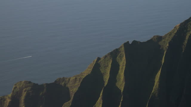 massive spine of kauai island mountain running to the sea - butte rocky outcrop stock videos & royalty-free footage