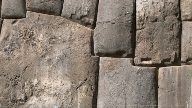 ms massive stone wall and gate of inca fortress at sacsayhuaman / cuzco, peru - stone material stock videos & royalty-free footage