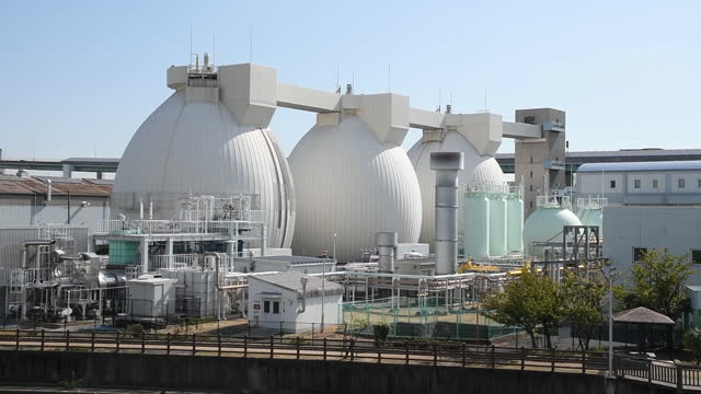 massive storage tanks at new hydrogen facilities on port island in kobe, japan on monday, october 26, 2020. - nuovo video stock e b–roll